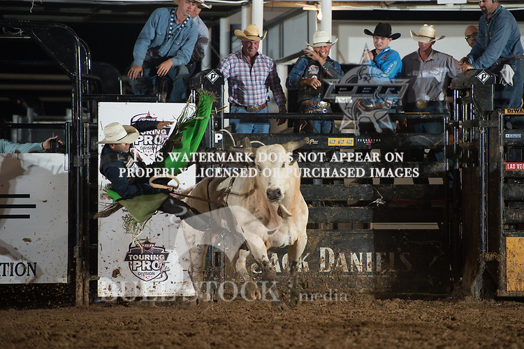 Ricky Aguiar attempts Zorro The Torro of Hudgins Bucking Bulls during the JW Hart Challenge event in Decatur, TX - 6.3.2016. Photo by Christopher Thompson