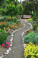Gravel path and bench at Northwest Garden Nursery, Eugene, Oregon
