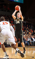 Wake Forest forward Tyler Cavanaugh (34) shoots over Virginia forward Akil Mitchell (25) during the first half of an NCAA basketball game Wednesday Jan. 08, 2014 in Charlottesville, VA. (Photo/The Daily Progress/Andrew Shurtleff)
