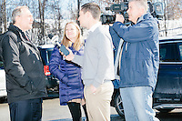 WMUR news reporter Mike Cronin and videographer Chris McDevitt interview former Virginia governor and Republican presidential candidate Jim Gilmore as he greets people outside the polling station for Manchester's Ward 2 at Hillside Middle School in Manchester, New Hampshire, on the day of primary voting, Feb. 9, 2016. Gilmore NH state director Anne Smith looks on. Gilmore finished in last place among major Republican candidates still in the race with a total of 150 votes.