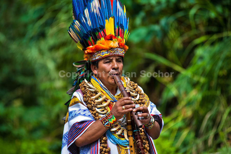 "A shaman from the Kamentsá tribe, wearing a colorful feather headgear, plays flute during the Carnival of Forgiveness, a traditional indigenous celebration in Sibundoy, Colombia, 12 February 2013. Clestrinye (""Carnaval del Perdón"") is a ritual ceremony kept for centuries in the Valley of Sibundoy in Putumayo (the Amazonian department of Colombia), a home to two closely allied indigenous groups, the Inga and Kamentsá. Although the festival has indigenous origins, the Catholic religion elements have been introduced and merged with the shamanistic tradition. Celebrating annually the collaboration, peace and unity between tribes, they believe that anyone who offended anyone may ask for forgiveness this day and all of them should grant pardons."