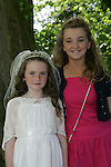 Isabelle Scanlon with her cousin Kerry Brady at Sandpit Church for her First Communion on Saturday.
