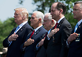 President Donald Trump (L), Vice President Mike Pence (2nd-L) Attorney General Jeff Sessions (3rd-L) and Health and Human Services Secretary Alex Azar stand for the national anthem during the 37th Annual National Peace Officers' Memorial Service at the U.S. Capitol Building on May 15, 2018 in Washington, D.C. <br /> Credit: Kevin Dietsch / Pool via CNP