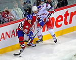4 December 2008: Montreal Canadiens' defenseman Mathieu Dandenault controls the puck as he is checked by New York Rangers' left wing forward Petr Prucha from the Czech Republic at the Bell Centre in Montreal, Quebec, Canada. The Canadiens, celebrating their 100th season, played in the circa 1915-1916 uniforms for the evenings' Original Six matchup. The Canadiens defeated the Rangers 6-2. *****Editorial Use Only*****..Mandatory Photo Credit: Ed Wolfstein Photo