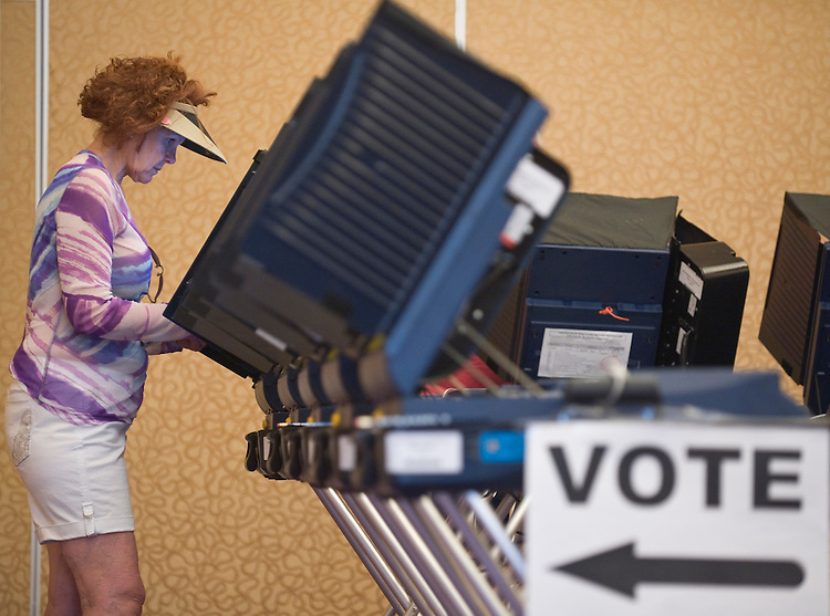 An early voter casts her ballot at the Sun City Anthem Community Center in Henderson, Nev., on Sunday morning, May 30, 2010. The official election day is June 8, but polls opened for ealry voting on May 22.