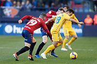 Carlos Clerc (defender; CA Osasuna) and Kike Barja (forward; CA Osasuna) during the Spanish football of La Liga 123, match between CA Osasuna and AD Alcorcón at the Sadar stadium, in Pamplona (Navarra), Spain, on Sanday, December 16, 2018.