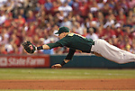 June 18, 2010      Oakland Athletics first baseman Daric Barton (10) dives for a line drive to right field hit by St. Louis Cardinals second baseman Skip Schumaker (55) in the fifth inning, sending St. Louis Cardinals shortstop Brendan Ryan (13) to third base.  The St. Louis Cardinals defeated the Oakland Athletics 6-4 in the first game of a three-game homestand at Busch Stadium in downtown St. Louis, MO on Friday June 18, 2010.