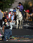 Aubriella WIlliams, 3, and Max Auchenbach, 2, play with bubble blowers while watching the Nevada Day parade in Carson City, Nev. on Saturday, Oct. 27, 2012. .Photo by Cathleen Allison