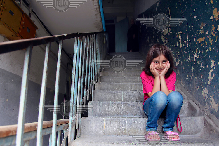 Sovinar, nine, who, along with her brothers, lives with her grandmother after her mother abandoned them and her father confined to a mental hospital.