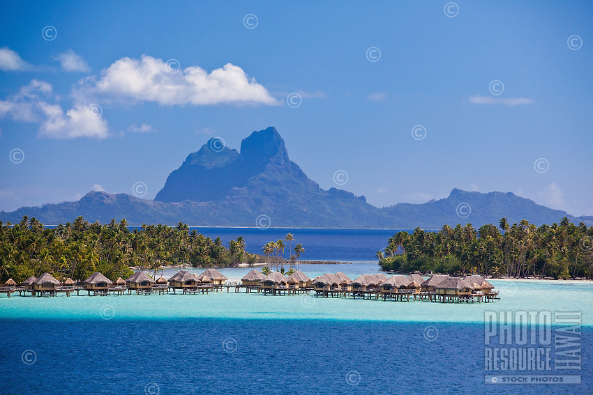 Bora Bora seen from lagoon with over water bungalows