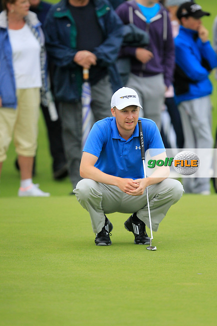 Simon Ward (Co. Louth) on the 17th green during the South of Ireland Amateur Open Championship Final at Lahinch Golf Club  31th July 2013 <br /> Picture:  Thos Caffrey / www.golffile.ie