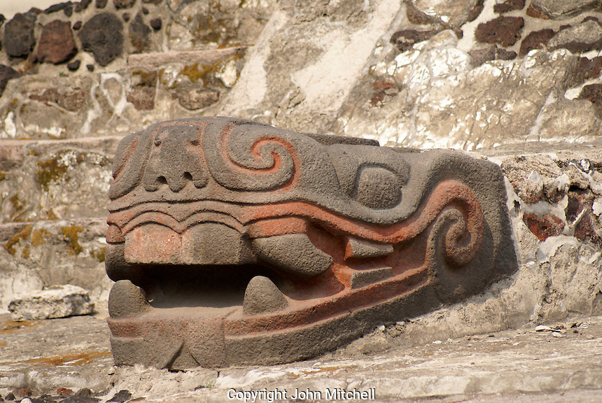 Serpent head scupture with original colouring at Aztec ruins of the Templo Mayor or Great Temple of Tenochtitlan, Mexico City