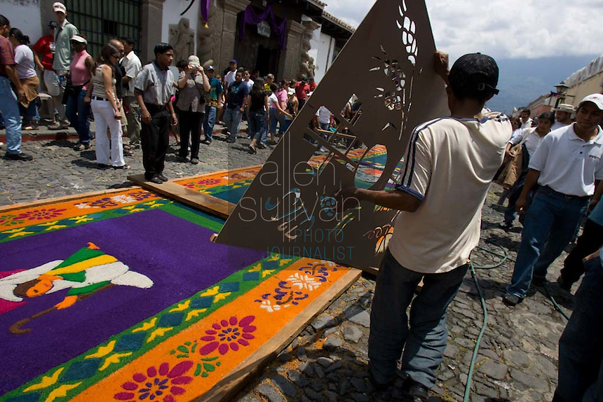 People make alfombras--carpets of colored sawdust--on the cobblestone 5a Avenida Norte during the Penance of Jesus procession.