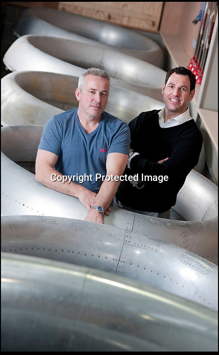 BNPS.co.uk (01202 558833)<br /> Pic: PhilYeomans/BNPS<br /> <br /> Bespoke furniture for the Jet Set.<br /> <br /> Shane and Brett Armstrong in amongst some engine intakes awaiting transformation.<br /> <br /> Two brother's have come up with ultimate in aircraft recycling - turning unwanted bits of redundant airliners into highly desirable - and highly expensive - bespoke items of furniture.<br /> <br /> Brett and Shane Armstrong from Kent scour the worlds aircraft graveyards looking for interesting items they can rescue from sad decay and with a lot of imagination and elbow grease convert into one-off gleaming items of furniture costing thousands of pounds.