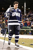 Justin Agosta (UNH - 12) - The University of Maine Black Bears defeated the University of New Hampshire Wildcats 5-4 in overtime on Saturday, January 7, 2012, at Fenway Park in Boston, Massachusetts.