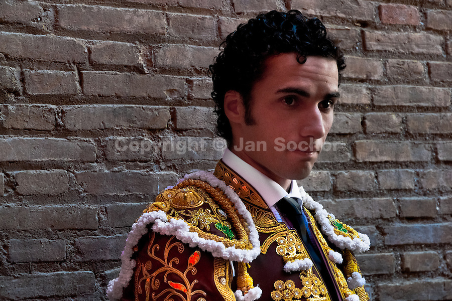 A young Spanish bullfighter (matador) enters the bullring in Granada, Spain, 7 June 2006.