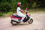 Mathumita rides her scooter during the field visits in Punaineeravi village in Kilinochchi in Northern Sri Lanka. Photo: Sanjit Das/Panos