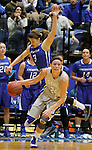 BROOKINGS, SD - NOVEMBER 18:  Megan Waytashek #24 from South Dakota State University drives past MC McGrory #3 from Creighton in the first half of their game Tuesday night at Frost Arena in Brookings. (Photo by Dave Eggen/Inertia)