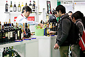 FOODEX JAPAN 2015, March 4, 2015, Chiba, Japan : An exhibitor offers samples of wine at the Italy booth during the 40th International Food and Beverage Exhibition (FOODEX JAPAN 2015) in Makuhari Messe International Convention Complex. About 2,800 exhibitors from 83 nations participate in the Asian's largest food and beverage trade show. This year organizers expect 75,000 visitors for the four day event, which runs from March 3rd to 6th. (Photo by Rodrigo Reyes Marin/AFLO)