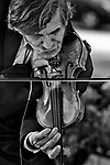An old man playing the violin