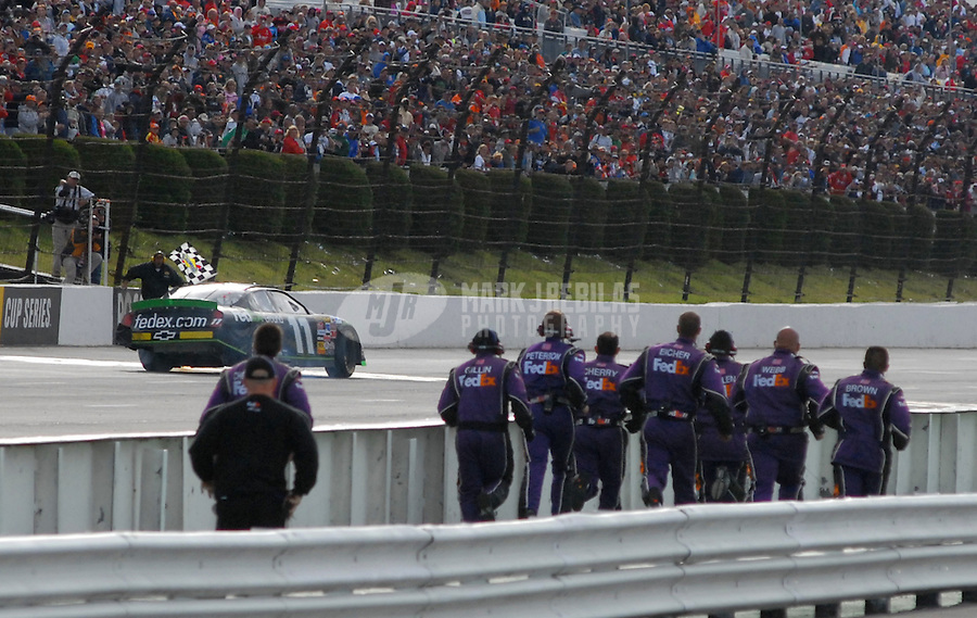 June 11, 2006; Long Pond, PA, USA; The crew of Nascar Nextel Cup driver Denny Hamlin (11) celebrate after winning the Pocono 500 at Pocono Raceway. Mandatory Credit: Mark J. Rebilas