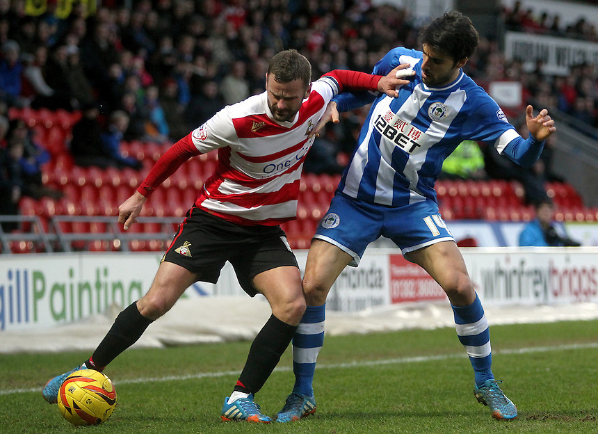 Doncaster Rovers' Richard Wellens holds off the challenge from Wigan Athletic's Jordi Gomez<br /> <br /> Photo by Rich Linley/CameraSport<br /> <br /> Football - The Football League Sky Bet Championship - Doncaster Rovers v Wigan Athletic - Saturday 18th January 2014 - Keepmoat Stadium - Doncaster<br /> <br /> &copy; CameraSport - 43 Linden Ave. Countesthorpe. Leicester. England. LE8 5PG - Tel: +44 (0) 116 277 4147 - admin@camerasport.com - www.camerasport.com