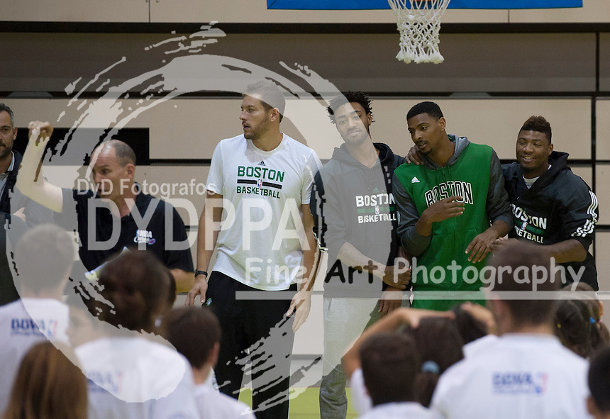 NBA coach Neal Meyer and Boston Celtics basketball players Jordan Mickey, David Lee, Marcus Smart and James Young