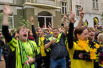 Fans watching and cheering  because of the goals of their favorite soccer club BVB 09  while playing its last match of the saison. BVB won the title in the German Premium League and this last match too.