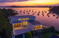 BNPS.co.uk (01202 558833)<br /> Pic: LillicrapChilcott/BNPS<br /> <br /> Seaside sunsets...<br /> <br /> A brand new futuristic property perched right on the edge of a sea wall overlooking some of the finest sailing waters in the country has gone up for sale for £4.5m.<br /> <br /> The ultra-modern home and just been built on remote headland in the Cornish sailing village of St Just.<br /> <br /> It replaced a large bungalow that stood on the coastal plot for over 80 years and was demolished by owner and architect Callum Wason.