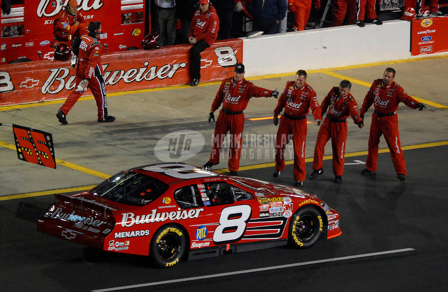 Oct 14, 2006; Concord, NC, USA; Nascar Nextel Cup driver Dale Earnhardt Jr (8) is wished well by his crew during the Bank of America 500 at Lowes Motor Speedway. Mandatory Credit: Mark J. Rebilas