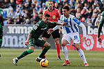 CD Leganes's Mikel Vesga and Real Betis Balompie's Sergio Leon during La Liga match between CD Leganes and Real Betis Balompie at Butarque Stadium in Madrid, Spain. February 10, 2019. (ALTERPHOTOS/A. Perez Meca)