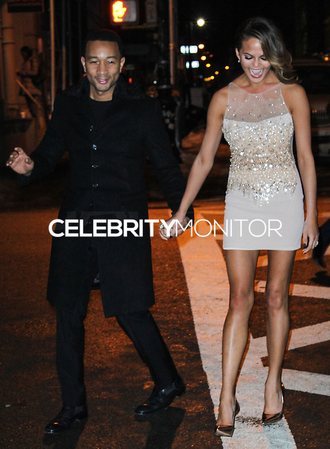 NEW YORK, NY - FEBRUARY 18: John Legend, Chrissy Teigen at the Sports Illustrated Swimsuit 50th Anniversary Party held at Swimsuit Beach House on February 18, 2014 in New York City. (Photo by Jeffery Duran/Celebrity Monitor)