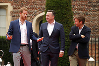 Prince Harry Duke of Cambridge walks with the Managing Director of Audi UK Andrew Doyle, centre, and the Chairman of Sentebale Johnny Hornby, right during the concert hosted by his charity Sentebale at Hampton Court Palace, in London. The concert will raise funds and awareness for Sentebale, the charity founded by Prince Harry and Lesotho's Prince Seeiso in 2006, to support children and young people affected by HIV and AIDS in Lesotho, Botswana and Malawi. Photo Credit: ALPR/AdMedia