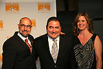 Stanley Tucci & Emeril Lagasse and his wife Alden at the Food Bank for New York City as they present the 8th Annual Can-Do Awards Dinner 2010 on April 20, 2010 at Pier Sixty at Chelsea Piers, New York City, New York. (Photo by Sue Coflin/Max Photos)