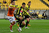 Wellington Phoenix&rsquo; Andrija Kaluderovic and Brisbane&rsquo;s Jack Hingert in action during the A League - Wellington Phoenix v Brisbane Roar FC at Westpac Stadium, Wellington, New Zealand on Saturday 28 October.<br /> Photo by Masanori Udagawa. <br /> www.photowellington.photoshelter.com