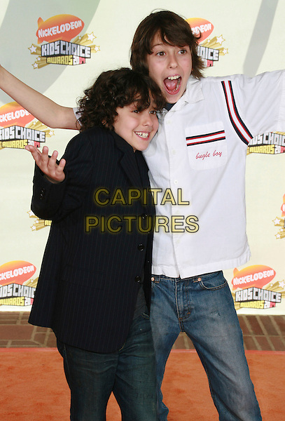 ALEX WOLFF & NAT WOLFF.20th Annual Nickelodeon Kids' Choice Awards held at UCLA's Pauley Pavilion, Westwood, California, USA..March 31s, 2007.half length black jacket white arms mouth open.CAP/ADM/CH.©Charles Harris/AdMedia/Capital Pictures