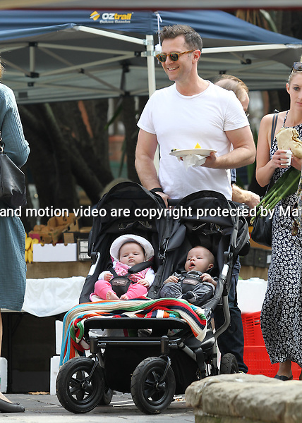 21 APRIL 2015 SYDNEY AUSTRALIA<br /> <br /> EXCLUSIVE PICTURES<br /> <br /> The entire Campbell brood hit the markets in Kings Cross. David Campbell pictured with his wife Lisa, their son Leo, and newborn twins Billy and Betty enjoying a stroll through the popular Kings Cross markets. The picture perfect family had a bite to eat, met up with friends, and  hit the playground to have a play with Leo and the twins. David was being swarmed by women cooing over Billy and Betty, but he skilfully dealt with them with a big smile on his face.<br /> <br /> *No web use without clearance*.<br /> MUST CONTACT PRIOR TO USE <br /> +61 2 9211-1088. <br /> <br /> Matrix Media Group.Note: All editorial images subject to the following: For editorial use only. Additional clearance required for commercial, wireless, internet or promotional use.Images may not be altered or modified. Matrix Media Group makes no representations or warranties regarding names, trademarks or logos appearing in the images.