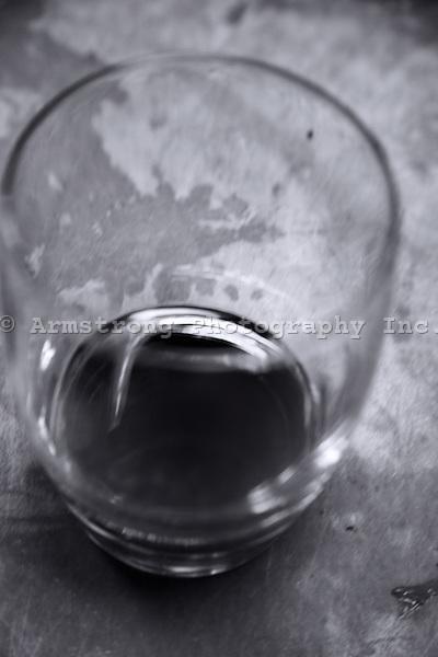 A mostly empty stemless wine glass.