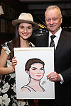 """Max Klimavicius with Phillipa Soo from the cast of """"The Parisian Woman"""" honored with a Sardi's Wall of Fame Portrait on February 28, 2018 at Sardi's in New York City."""
