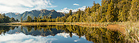 Winter morning at Lake Matheson with reflections of Mt. Cook and Mt. Tasman, Westland Tai Poutini National Park, UNESCO World Heritage Area, West Coast, New Zealand, NZ