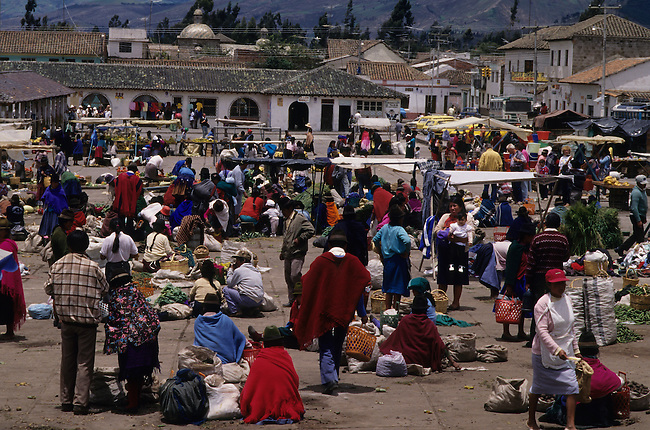 Local people buying goods at a market near Pujili in the highlands of Ecuador
