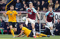 Burnley's Chris Wood controls under pressure from Wolverhampton Wanderers' Ruben Neves<br /> <br /> Photographer Rich Linley/CameraSport<br /> <br /> The Premier League - Burnley v Wolverhampton Wanderers - Saturday 30th March 2019 - Turf Moor - Burnley<br /> <br /> World Copyright © 2019 CameraSport. All rights reserved. 43 Linden Ave. Countesthorpe. Leicester. England. LE8 5PG - Tel: +44 (0) 116 277 4147 - admin@camerasport.com - www.camerasport.com