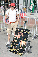 "A man brought a sign with James Brown and reading ""Say it loud / I'm Straight and I'm Proud"" to carry in the Straight Pride Parade in Boston, Massachusetts, on Sat., August 31, 2019."