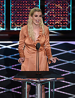"BEVERLY HILLS - SEPTEMBER 7: Ireland Baldwin appears onstage at the ""Comedy Central Roast of Alec Baldwin"" at the Saban Theatre on September 7, 2019 in Beverly Hills, California. (Photo by Frank Micelotta/PictureGroup)"