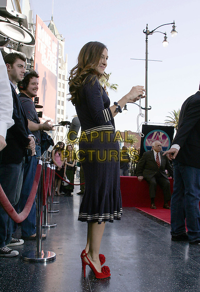 SARAH JESSICA PARKER.At the Star Ceremony on the Hollywood Walk of Fame Honoring Matthew Broderick and Nathan Lane, Hollywood, California..January 9th, 2006.Photo: William Scott/AdMedia/Capital Pictures.Ref: WS/ADM.full length blue dress red shoes heels.www.capitalpictures.com.sales@capitalpictures.com.© Capital Pictures.