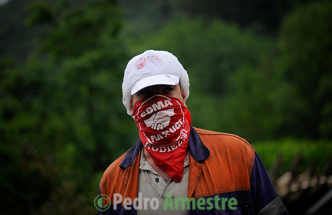 Spanish miners are seen during a miner's demonstration in Caborana, near Oviedo, in northern Spain on June 18, 2012. Spanish coal miners are staging a nationwide strike action organized by unions against the cash-strapped government's decision to slash subsidies to the sector this year to 111 million euros ($142 million) from 301 million euros last year. Unions argue the subsidy cuts will lead to the closure of Spain's coal mines and the loss of up to 30,000 direct and indirect jobs, since Spanish coal relies on state aid to compete with cheaper imports. .(c) Pedro ARMESTRE.