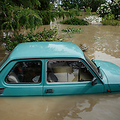 NOWY WIONCZENIN, POLAND, MAY 24, 2010:.Flooded Fiat 126 car..The latest chapter of disastrous floods in Poland has been opened yesterday, May 23, 2010, after Vistula river broke its banks and flooded over 25 villages causing evacualtion of most inhabitants..Photo by Piotr Malecki / Napo Images..NOWY WIONCZENIN, POLSKA, 24/05/2010:.Zatopiony fiat 126p.  Najnowszy akt straszliwych tegorocznych powodzi zostal rozpoczety wczoraj gdy Wisla przerwala waly na wysokosci wsi Swiniary kolo Plocka..Fot: Piotr Malecki / Napo Images ..