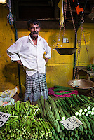 Portrait of a vegetable seller at his market stall in Kandy market, Kandy, Central Province, Sri Lanka Highlands, Asia. This is a portrait of a photo of vegetable seller at his market stall in Kandy market, Kandy, Central Province, Sri Lanka Highlands, Asia.