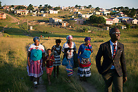 NDEVANA, SOUTH AFRICA MAY 5: Linamandla Deliwe walks in his village on May 5, 2018 in Ndevana, South Africa. Lina was born and lives in Cape Town but he grew up in Ndevana. He is a successful young man and the tries to uplift the community where his grandmother and many friends still live. Lina has given out many soccer kits, and he is soon opening a library, and he also wants to open a computer lab. The unemployment rate is huge  (about 80-90%) in this forgotten rural area about 50 km from east London, South Africa. (Photo by: Per-Anders Pettersson/Getty Images)