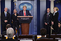 United States President Donald J. Trump speaks during a press conference with members of the coronavirus task force in the Brady Press Briefing Room of the White House on March 24, 2020 in Washington, DC.  Standing behind the President from left to right: US Vice President Mike Pence; Director of the National Institute of Allergy and Infectious Diseases at the National Institutes of Health Dr. Anthony Fauci; Director of the National Economic Council Larry Kudlow; and Dr. Deborah L. Birx, White House Coronavirus Response Coordinator.<br /> Credit: Oliver Contreras / Pool via CNP/AdMedia